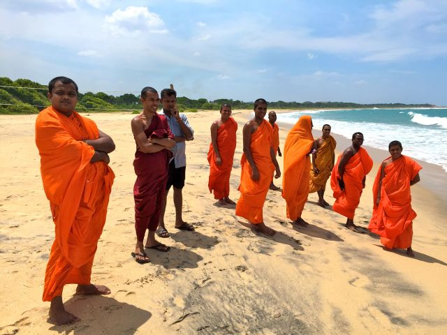 buddhist monks at peanut farm beach